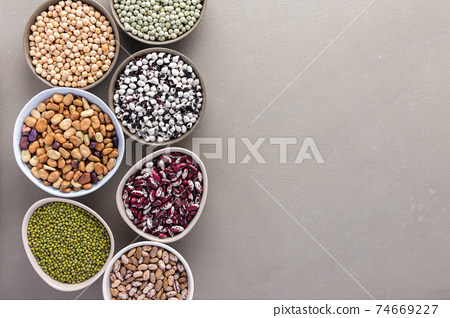 Different types of legumes in bowls 74669227