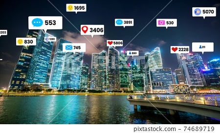 Social media icons fly over city downtown showing people engagement connection 74689719