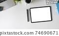 Top view image of workspace is surrounding by white screen tablet and office equipment. 74690671
