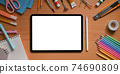 Top view image of artist workspace is surrounding by white blank screen computer tablet and stuff. 74690809