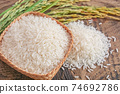 Jasmine rice in a wooden bowl with background. 74692786