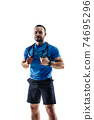 Caucasian professional male runner, athlete training isolated on white studio background. Copyspace for ad. 74695296