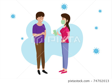 A woman handed a mask to a man who did not wear a medical mask. To prevent and stop the spread of the coronavirus. 74702013