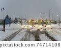 "Krakovets customs border cross point. Location (UA-PL) car pass through the Ukrainian-Polish border at the checkpoint ""Krakovets-Korchova"" at winter 74714108"