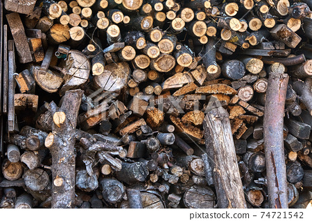Large stack of firewood from different wood 74721542