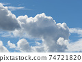 clouds in the blue sky 74721820
