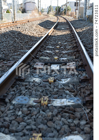 Railroad tracks that pass through railroad crossings in the Greater Tokyo Area 74723811