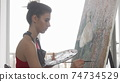 Young elegant woman painting at her workshop 74734529