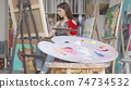 Selective focus on a palette at art studio of a young female artist 74734532