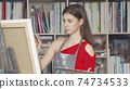 Charming young woman painting at art workshop 74734533