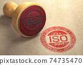 ISO 9001 certified concept. Rubber stamp with the text ISO 9001 on craft paper background. Quality control. 74735470