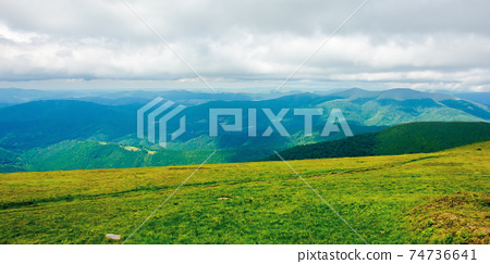 path through mountain meadow. beautiful carpathian landscape in summertime. clouds on the sky above the distant ridge. windy weather 74736641