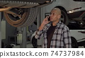 Young African man talking on the phone at car repair station 74737984