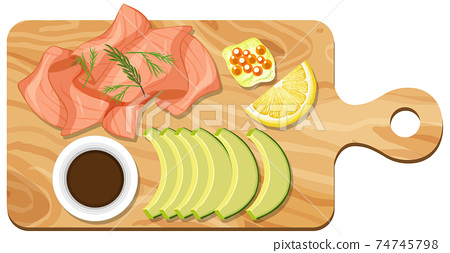Top view of salmon and avocado set on a cutting board isolated 74745798
