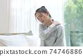 Tired woman sleep deprived stiff shoulder 74746886