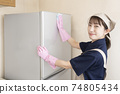 House cleaning woman wiping the fridge 74805434