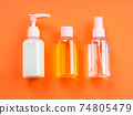 Generic beauty products on orange background. 74805479