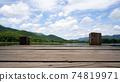 Panoramic view of Wooden bridge lake with Empty wooden floor. 74819971