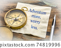 Adventure more, worry less - text on napkin 74819996