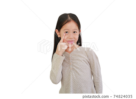 Asian little girl Sticking her tongue out to make faces, make grimace or make a wry face on white 74824035