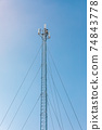 New telecommunication antenna on background of blue sky. Satellite dish telecom network at communication technology network. Telecom broadcasting tower. Modern cell tower 5G, 6G 74843778