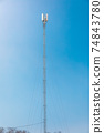 New telecommunication antenna on background of blue sky. Satellite dish telecom network at communication technology network. Telecom broadcasting tower. Modern cell tower 5G, 6G 74843780