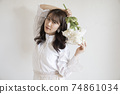 Portrait of woman with flowers 74861034