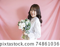 Portrait of woman with flowers 74861036