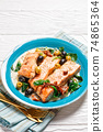 Salmon fish stew on a turquoise plate, top view 74865364