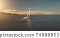 Aerial yacht regatta race at open sea. Amazing seascape of ocean waters at sun reflections 74886953