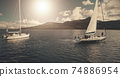 Sun over sailing regatta on luxury yachts aerial. Majestic sail boats race at ocean Brodick harbour 74886954