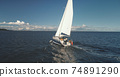 Closeup of yacht cruise at open sea with passengers aerial view. Sail boat at ocean with travelers 74891290