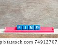 Tile letter on red rack in word find on wood background 74912707