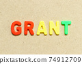Color alphabet letter with word grant on wood background 74912709