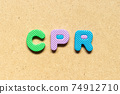 Foam alphabet letter in word CPR (abbreviation of Cardiopulmonary resuscitation) on wood background 74912710
