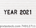 Black color letter in word year 2021 on white felt board background 74912711