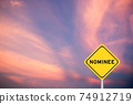 Yellow color transportation sign with word nominee on violet sky background 74912719