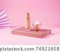 Make up foundation bottle and application brush on pink 74921658