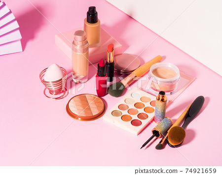 Different make up beauty cosmetics products on pink 74921659