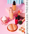 Different make up beauty cosmetics products on pink 74921661