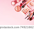 Different make up beauty cosmetics products on pink 74921662
