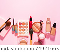 Different make up beauty cosmetics products on pink 74921665
