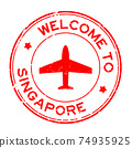 Grunge red welcome to Singapore word with airplane icon round rubber seal stamp on white background 74935925