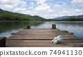 White Floral drop on Wooden bridge lake with Empty wooden floor.  74941130