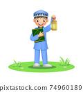 Happy muslim boy holding quran book with ramadan lantern 74960189
