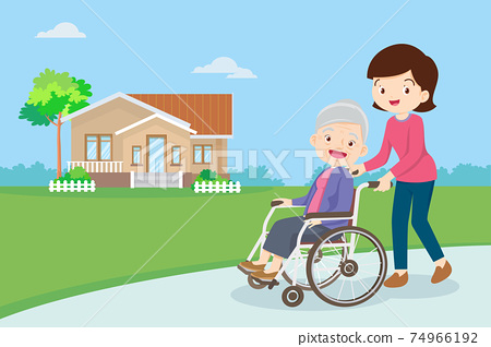 strolling with elderly woman in wheelchair in the park 74966192