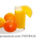Fresh orange juice in the glass 74978410