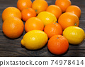 Lemons and oranges on brown wooden table 74978414