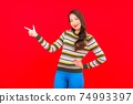 Portrait beautiful young asian woman smile with action on red background 74993397