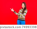 Portrait beautiful young asian woman smile with action on red background 74993398